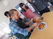 teacher Jun plating the meatballs in sweet and sour sauce